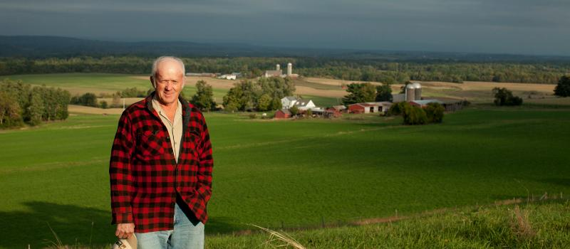 Ed Slocum overlooking farm